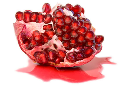 half of juicy ripe pomegranate (isolated, clipping path)
